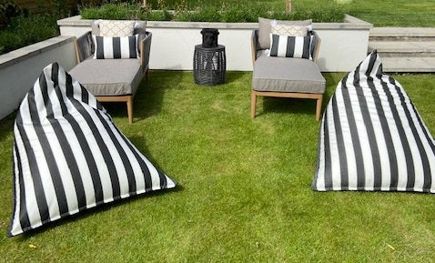 Custom monochrome striped humbug bean bag chairs on artificial grass with matching cushions