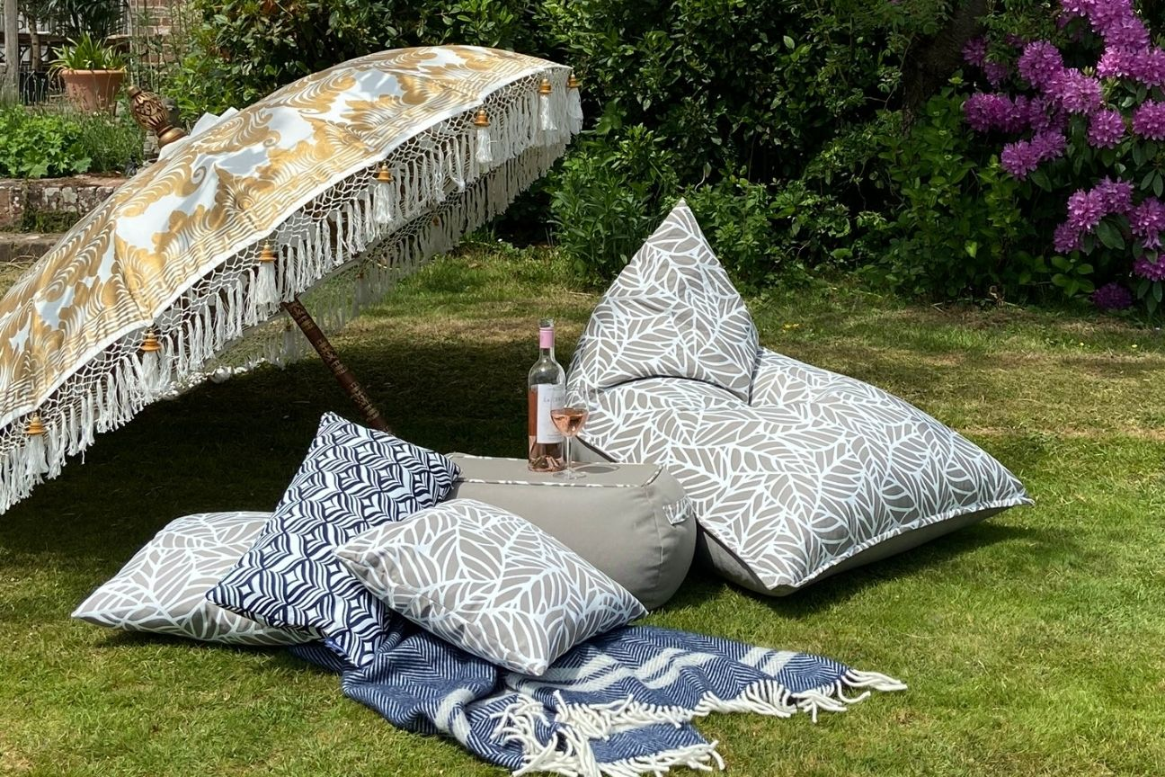 Armadillo Sun garden furniture sits on the grass ready to be relaxed on with a  cold beverage.
