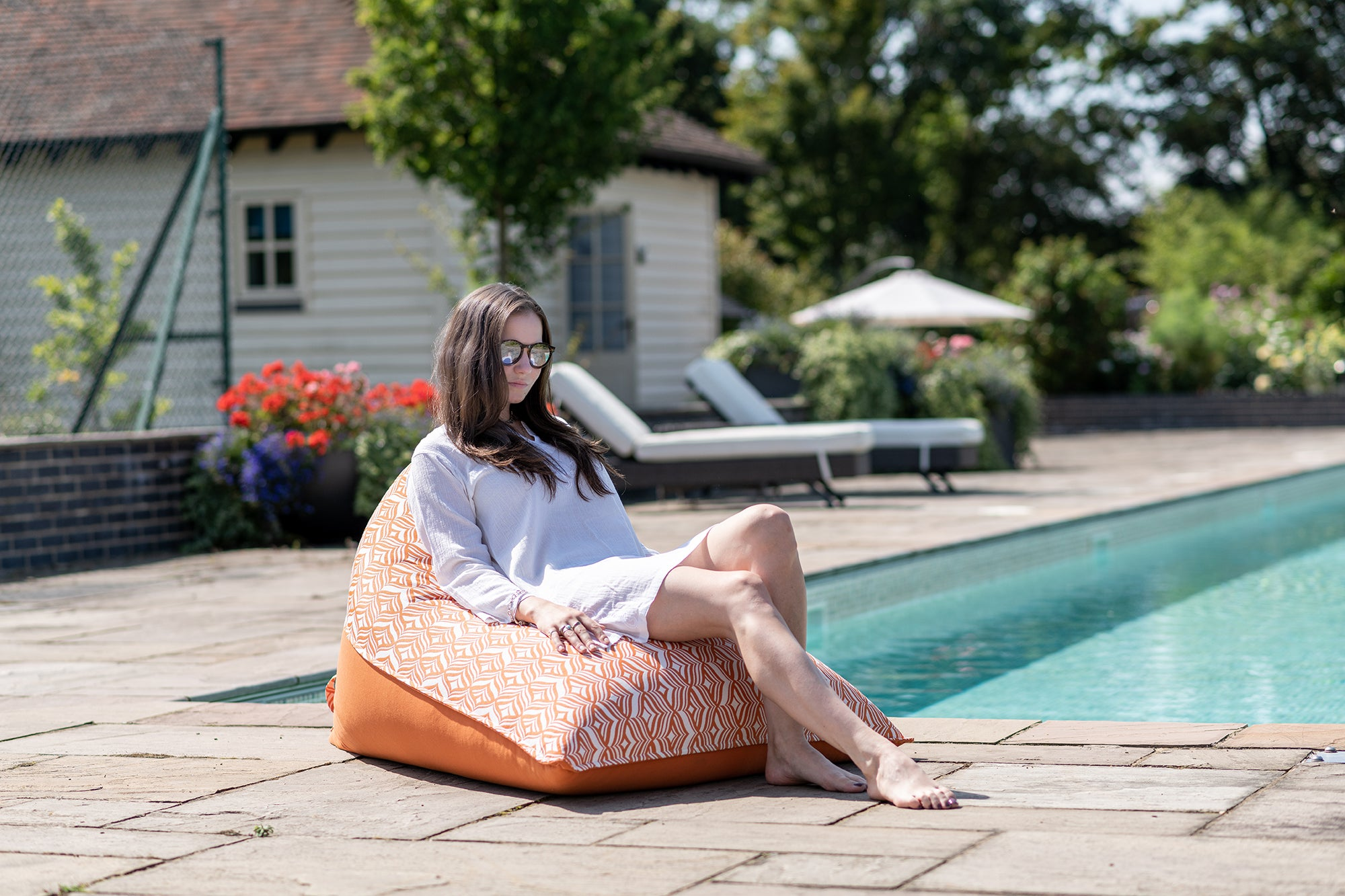 Orange Bean Bag Lounger with girl by the pool