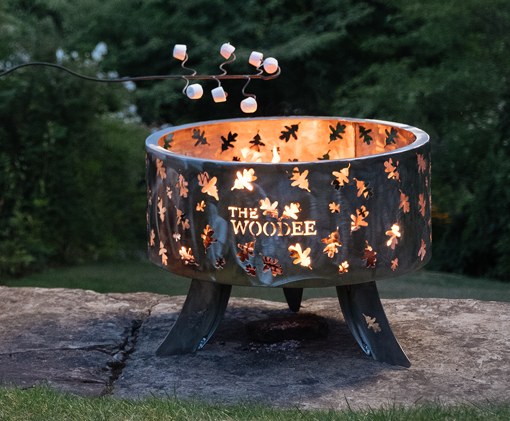 A beautiful Woodee fire pit with marshmallows ready to toast