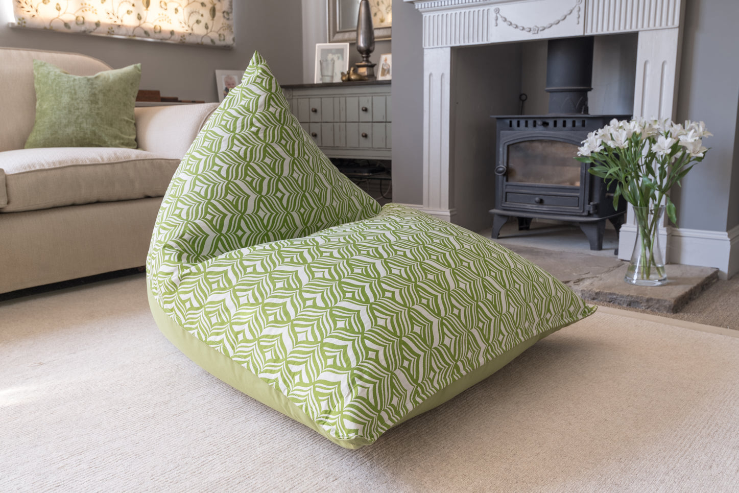 Armadillo Sun bean bag chair in green and white tulip design indoors