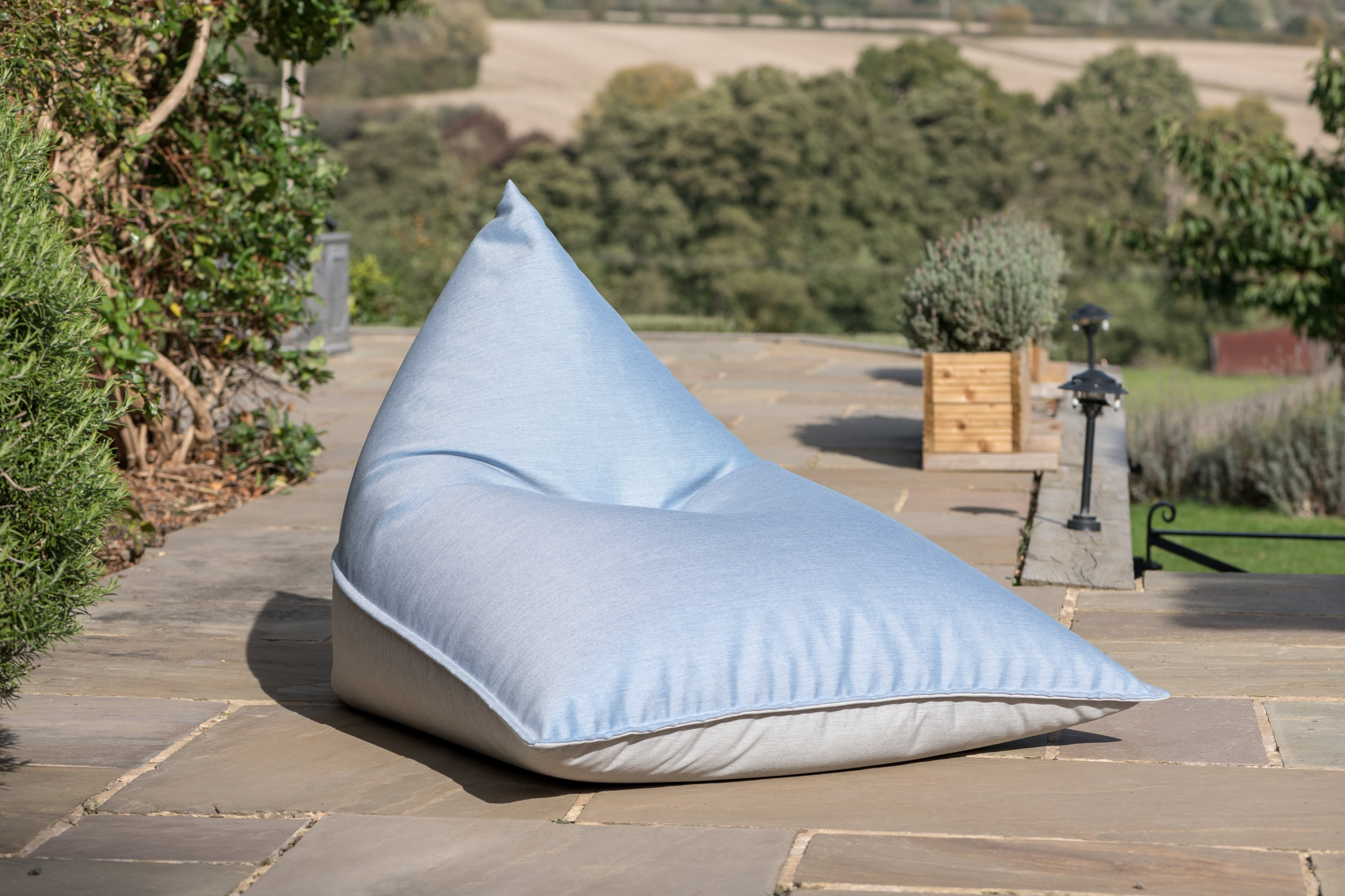 Armadillo Sun bean bag lounger in cool blue and grey fabric outdoors