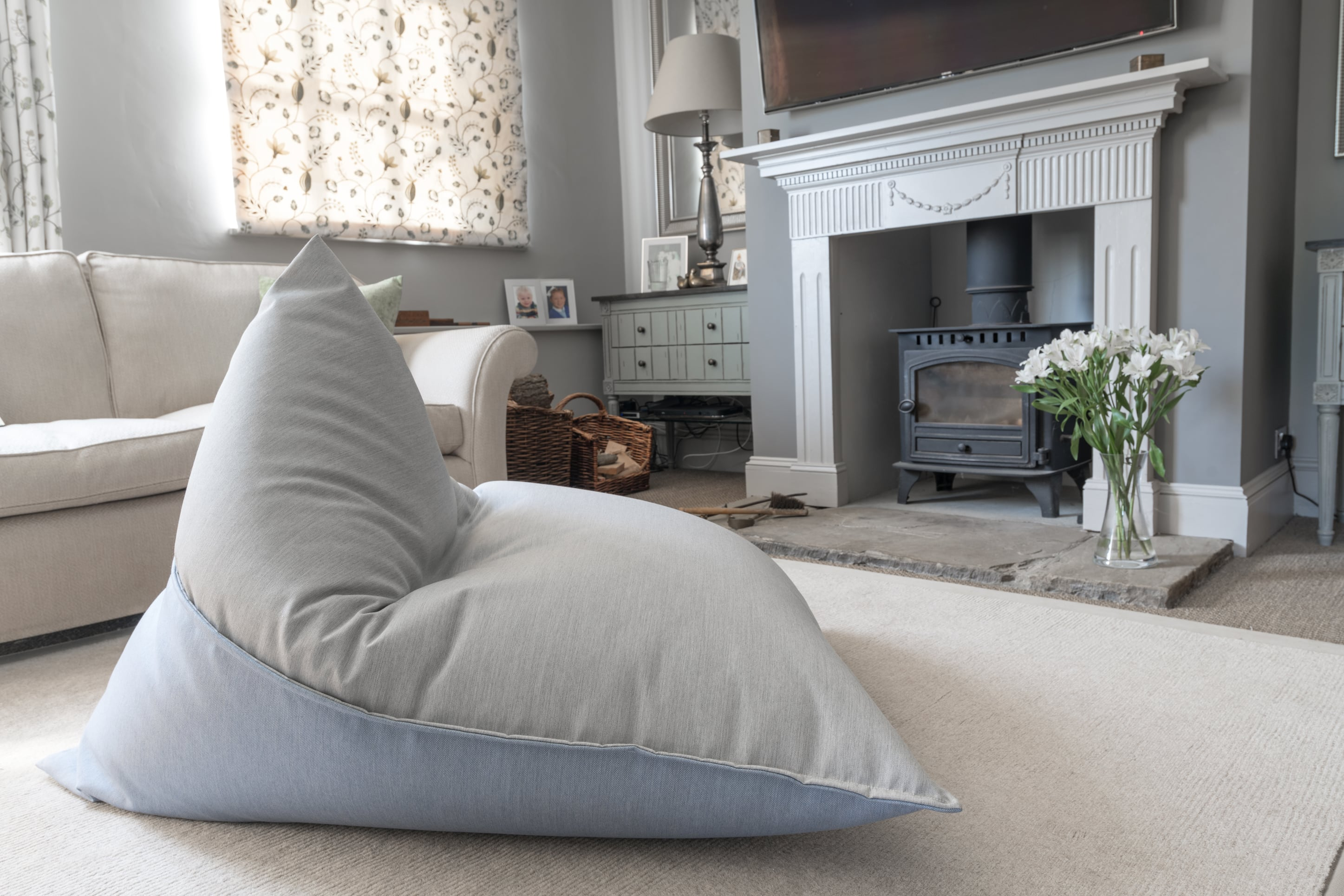 Armadillo Sun bean bag chair in ice blue and grey fabric indoors