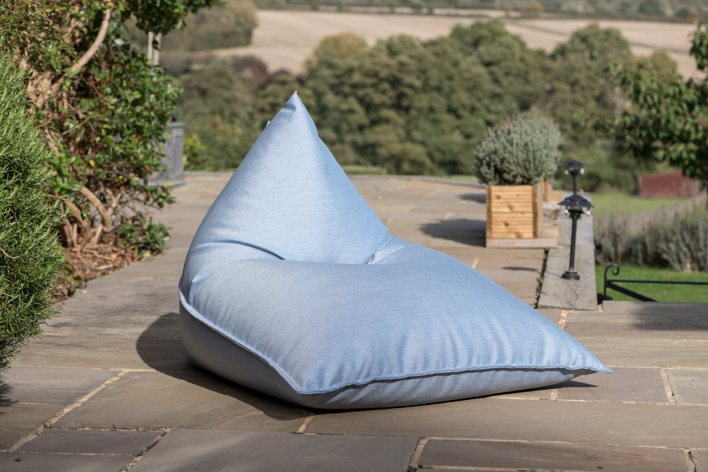 Armadillo Sun bean bag lounger in ice blue fabric outdoors