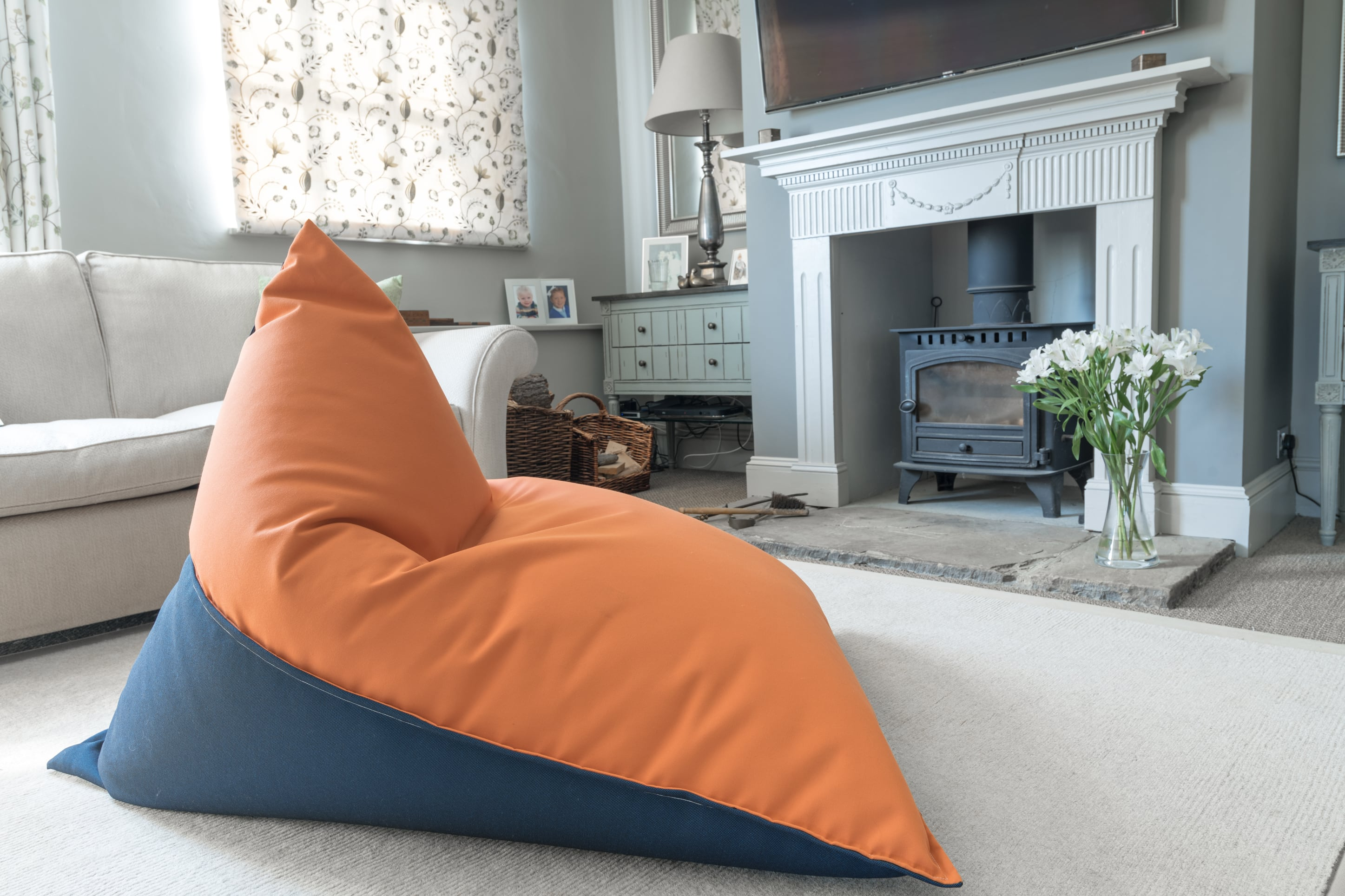 Armadillo Sun bean bag chair in orange and navy blue fabric inside