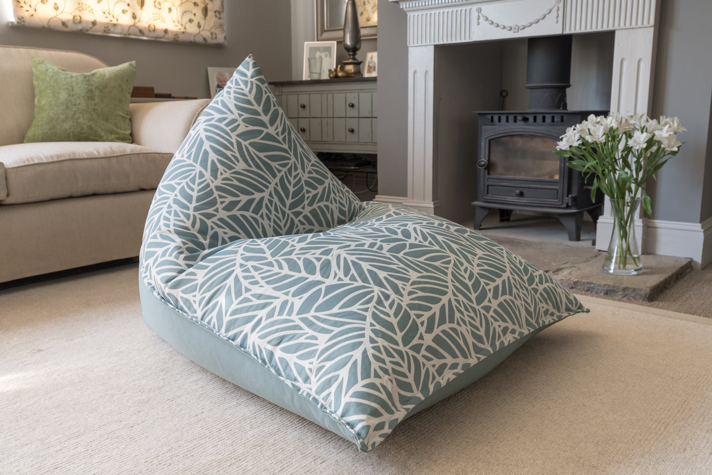 Armadillo Sun Bean Bag Chair in light teal blue and white pattern indoors