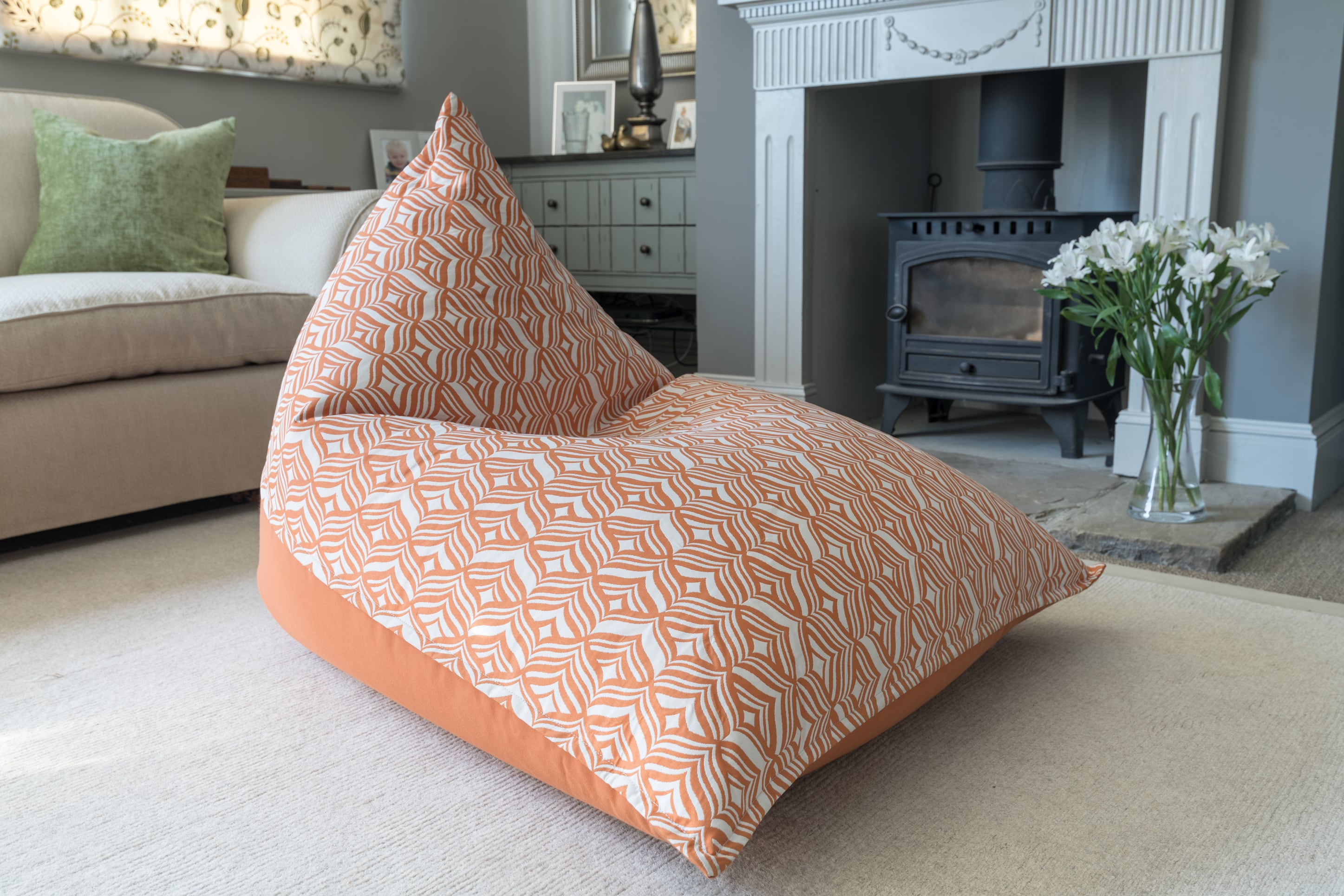 Armadillo Sun bean bag chair in orange and white tulip pattern indoors