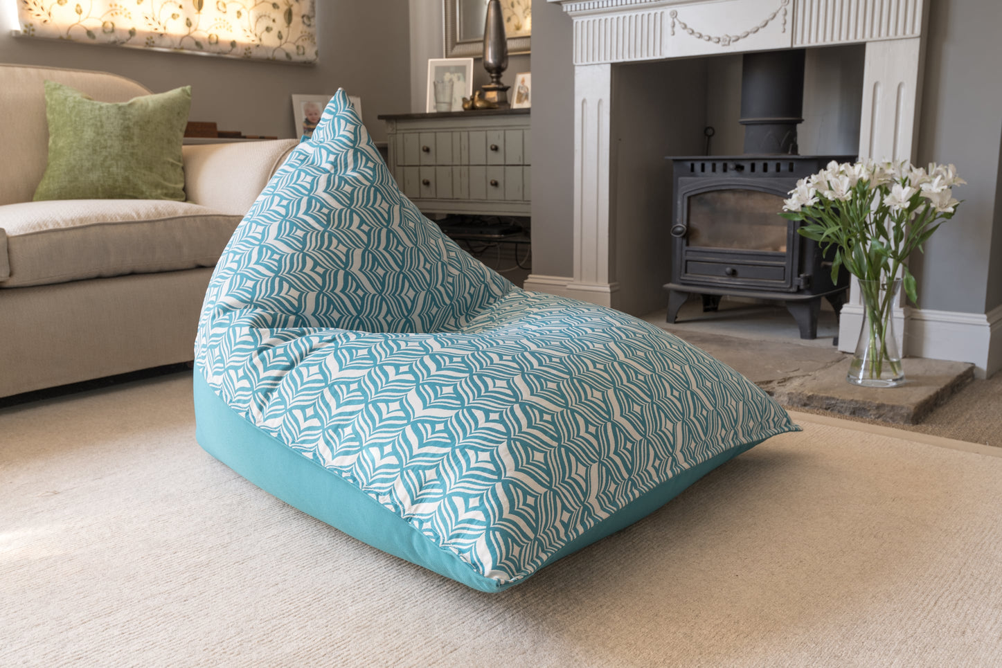 Armadillo Sun bean bag chair in turquoise blue and white tulip pattern indoors
