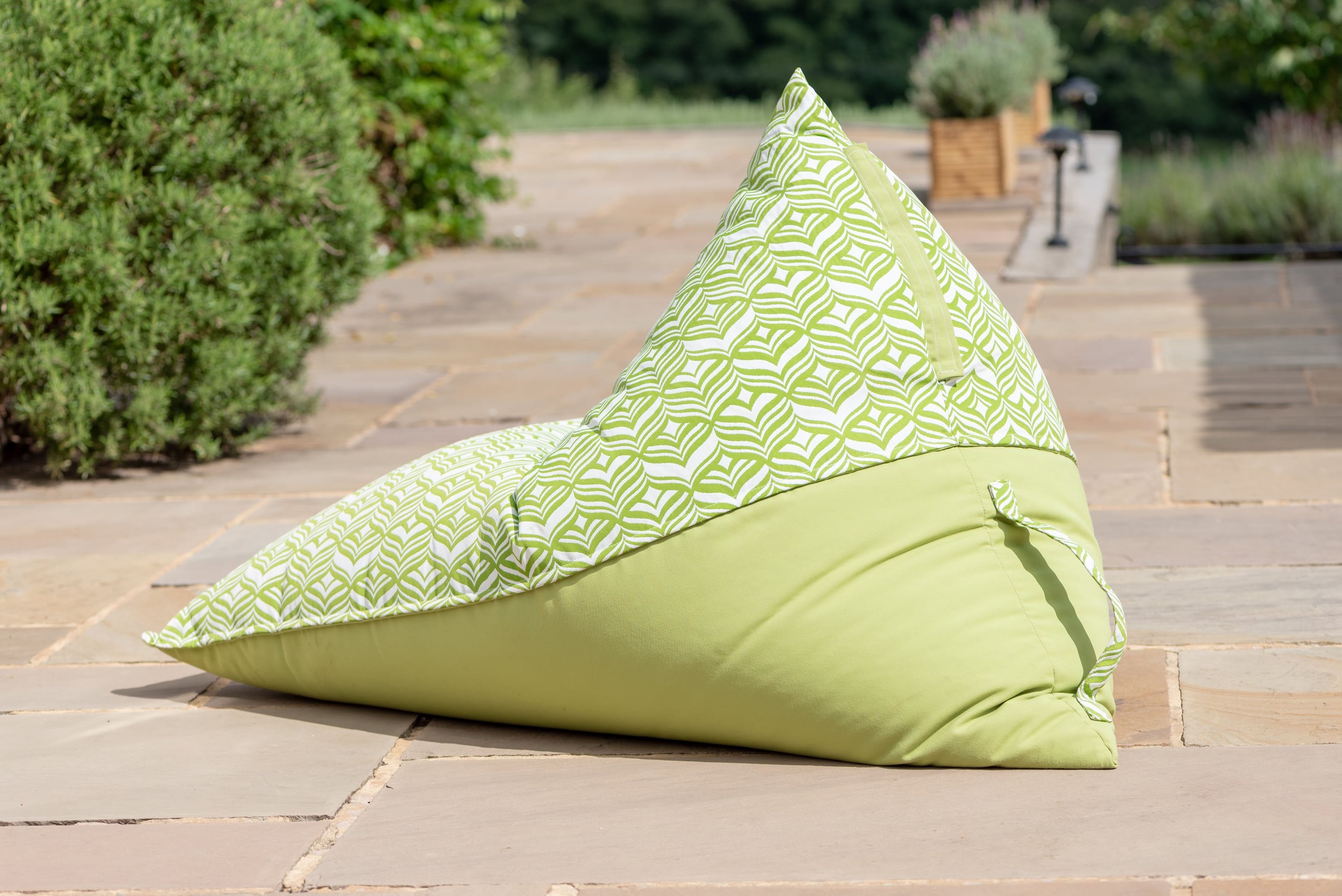 Armadillo Sun bean bag chair in green and white tulip design outdoors