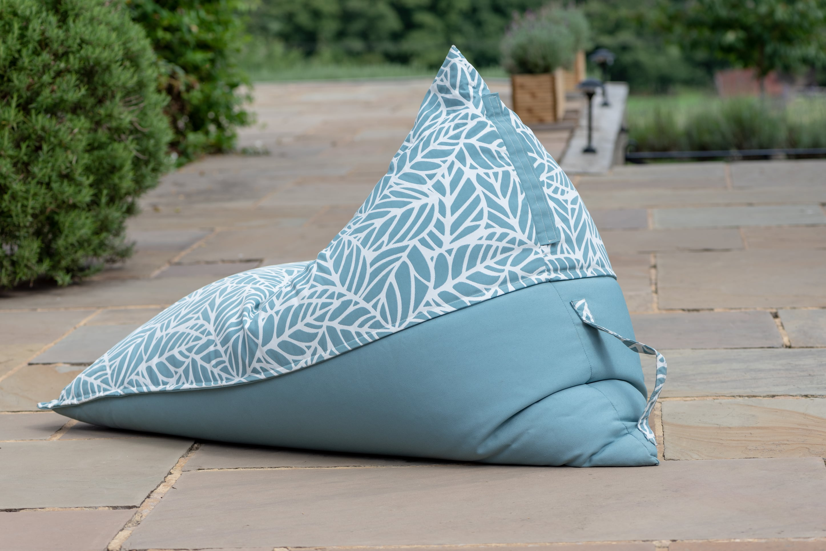 Armadillo Sun bean bag lounger in ocean blue and white palm pattern outdoor