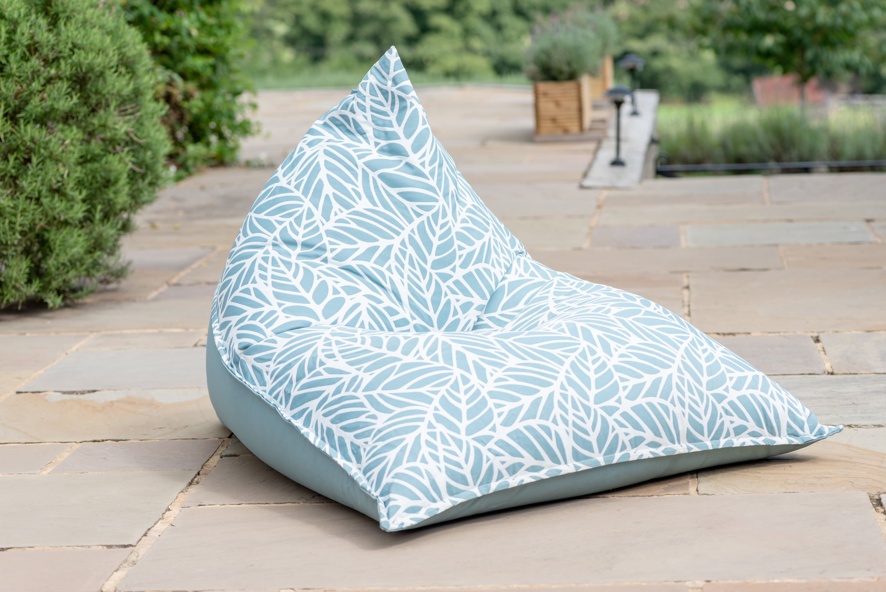 Armadillo Sun bean bag lounger in ocean blue and white palm pattern