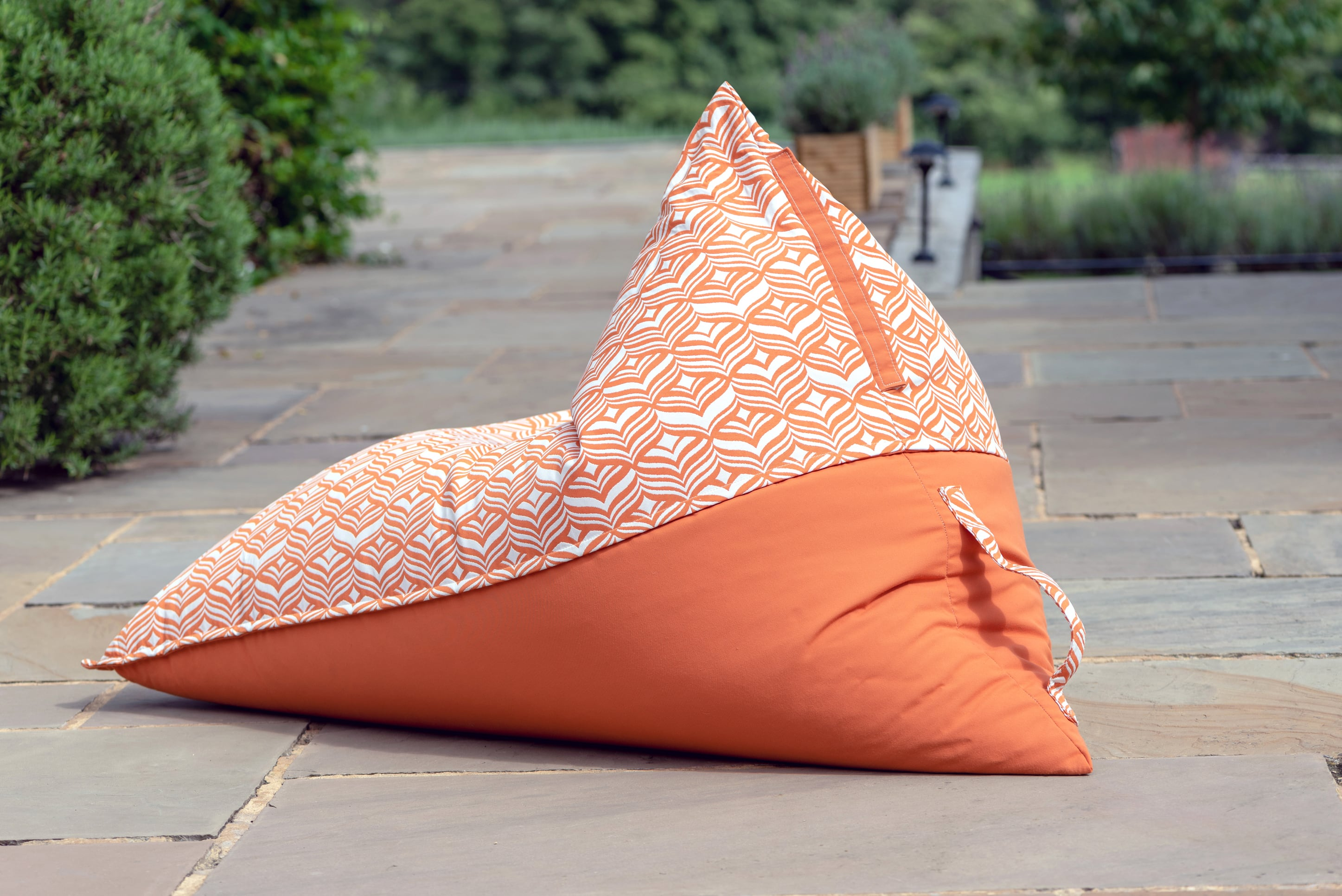 Armadillo Sun bean bag chair in orange and white tulip pattern outdoors