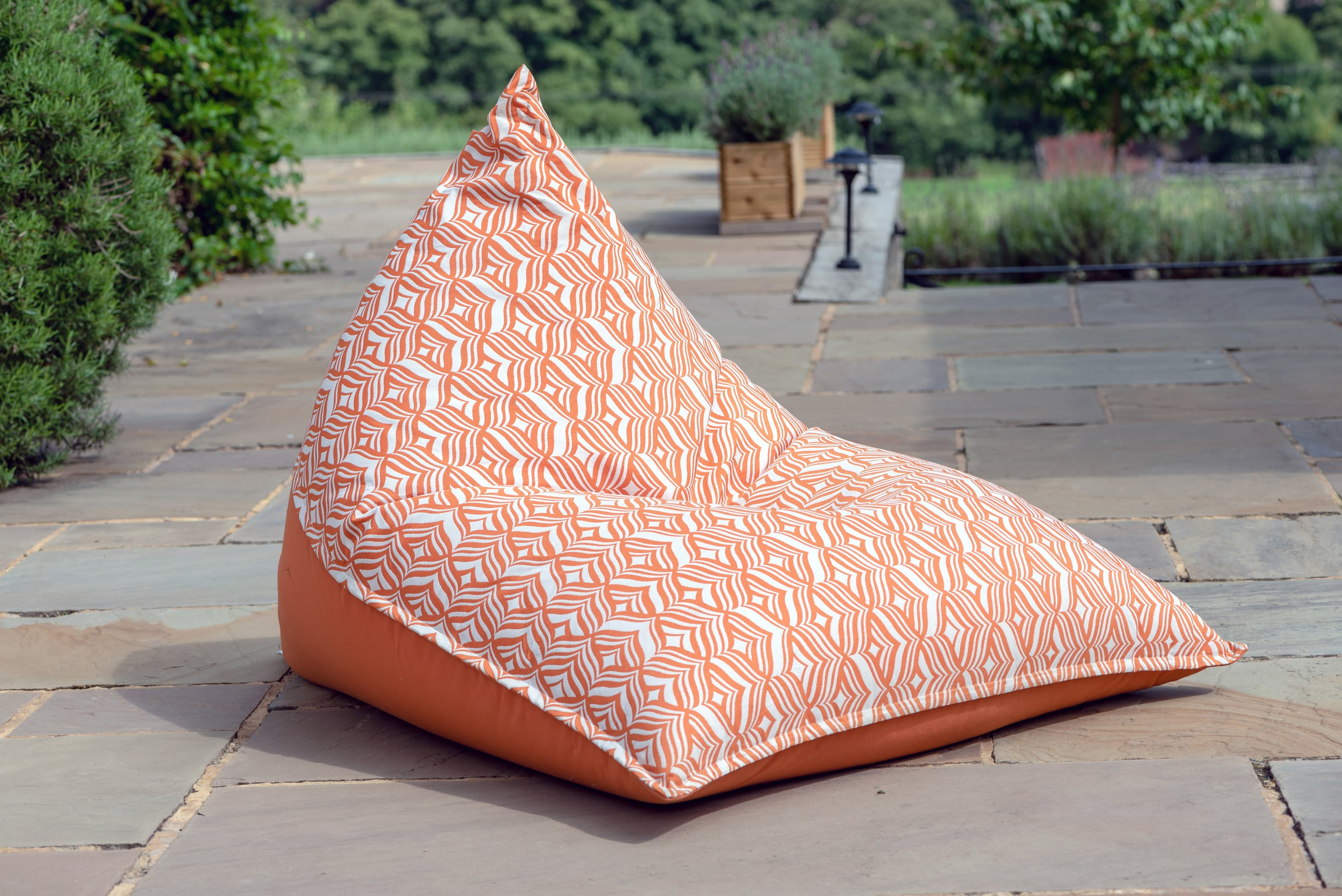 Armadillo Sun bean bag chair in orange and white tulip pattern