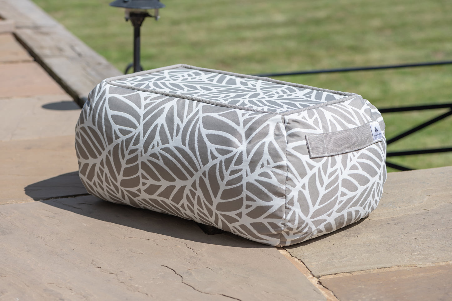 Armadillo Sun bean bag table in neutral pumice and white palm pattern