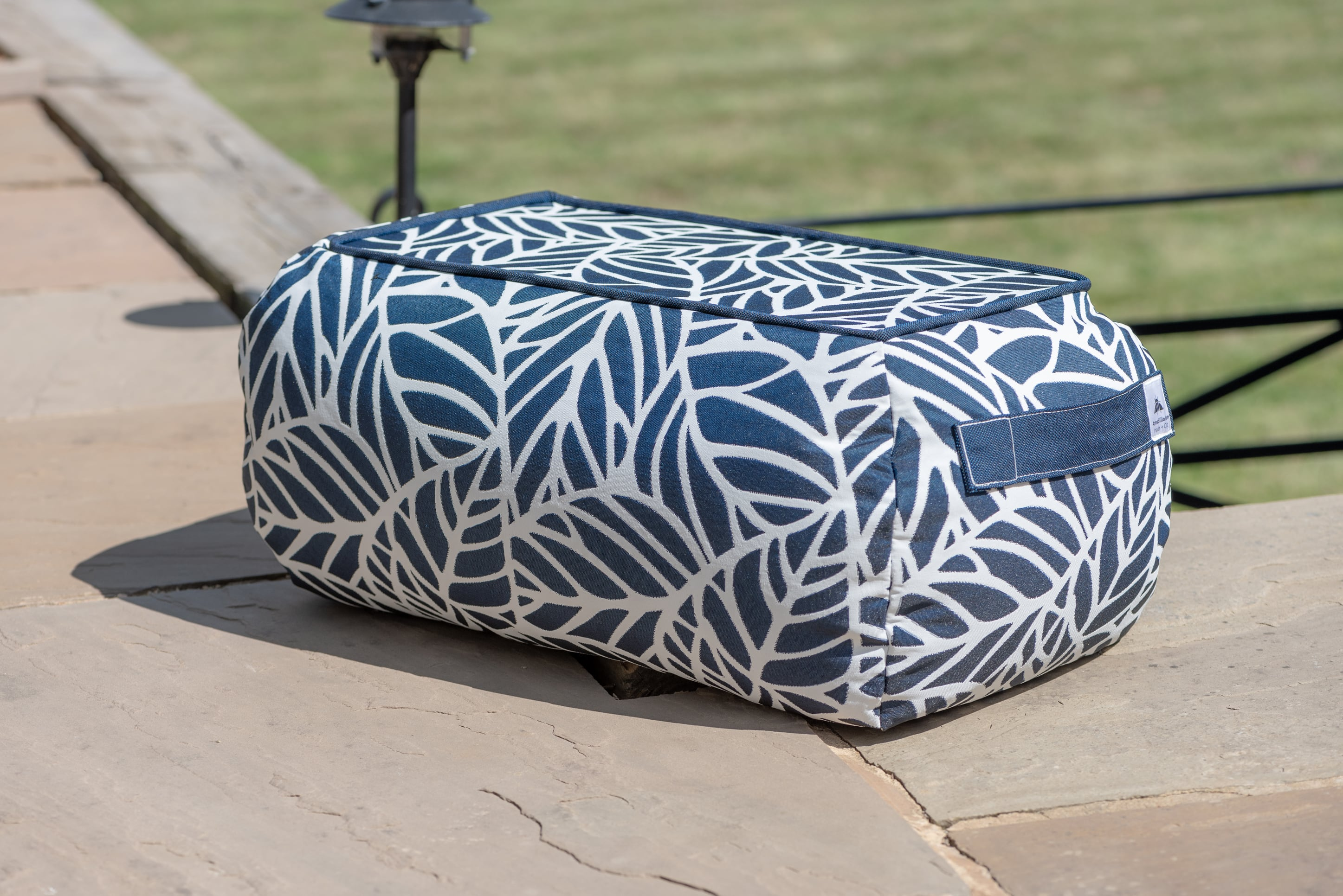 Armadillo Sun bean bag table in dark navy blue and white palm pattern