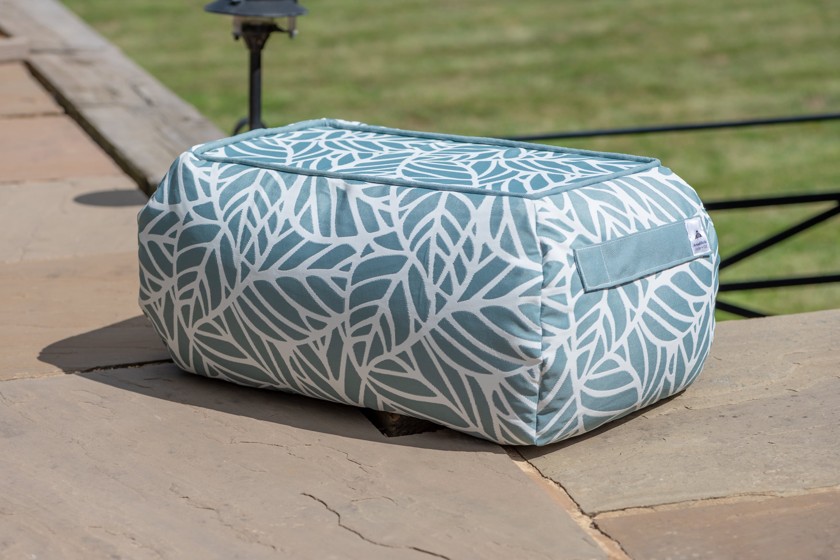 Armadillo Sun bean bag table in pale ocean blue and white palm pattern