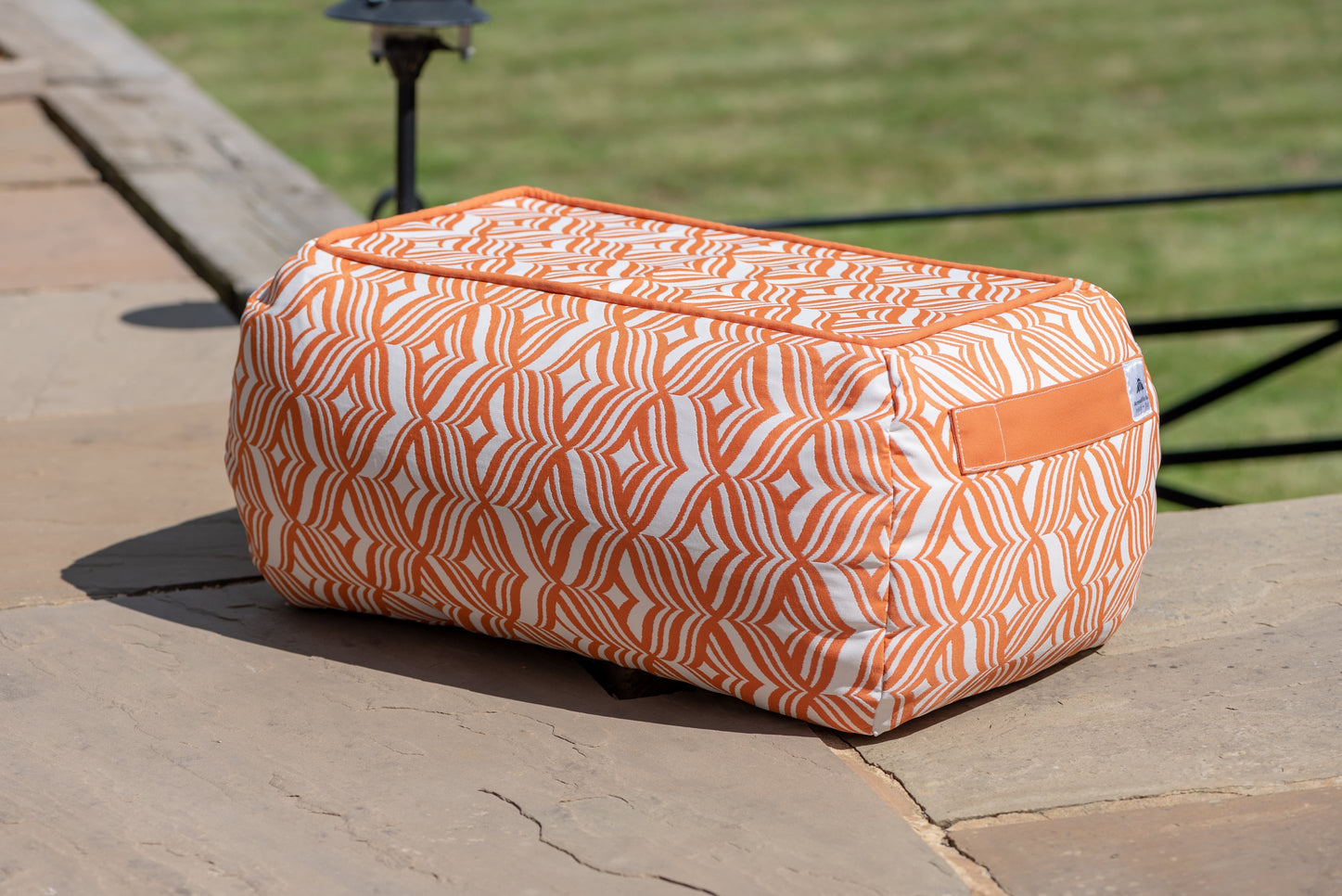 Armadillo Sun bean bag table in orange and white tulip pattern