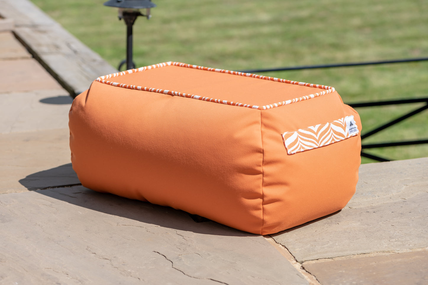 Armadillo Sun bean bag table in orange waterproof fabric
