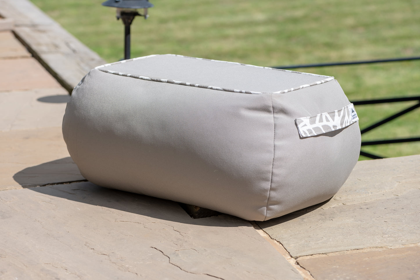 Armadillo Sun bean bag table in neutral taupe pumice colour outside