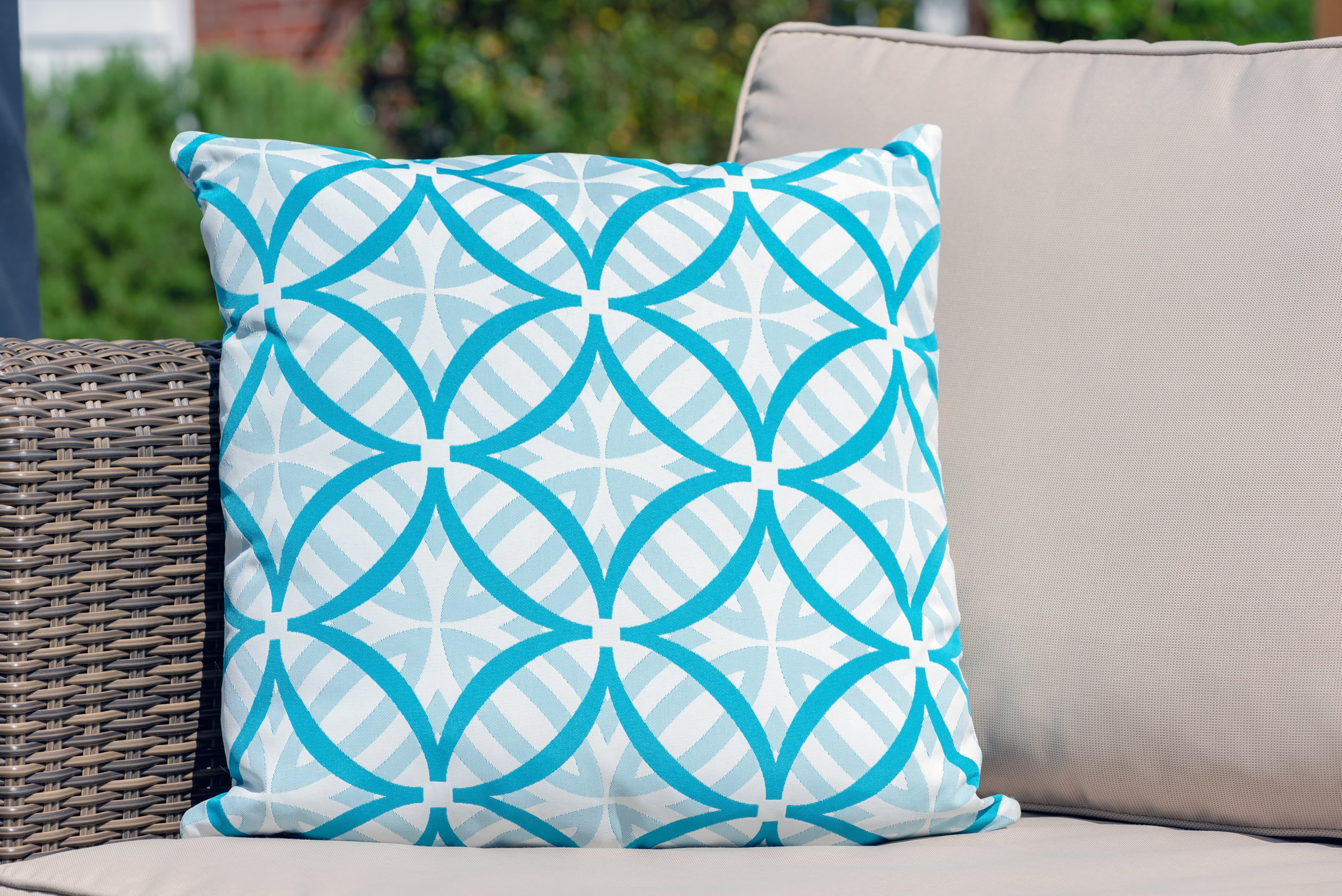 Armadillo Sun waterproof luxury cushion in turquoise and white pattern