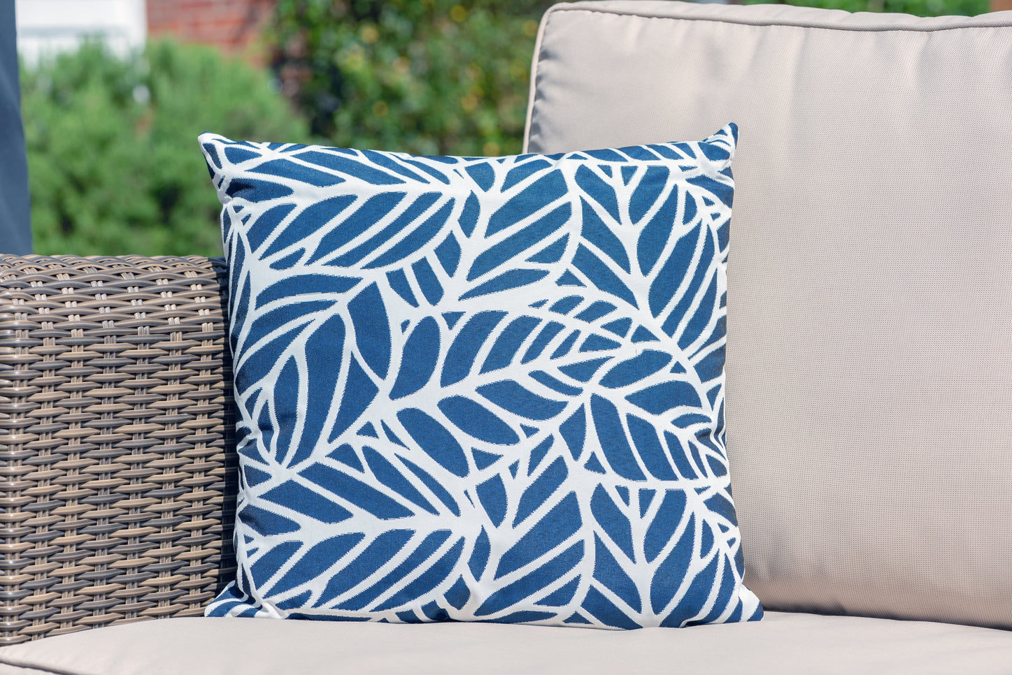 Armadillo Sun waterproof cushion in dark blue and white palm pattern