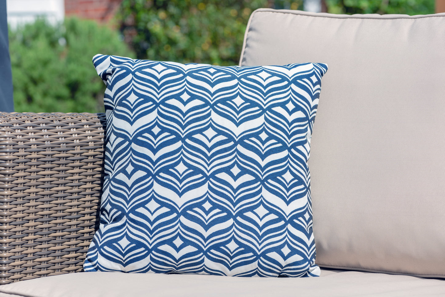 Armadillo Sun waterproof cushion in dark navy blue and white tulip pattern