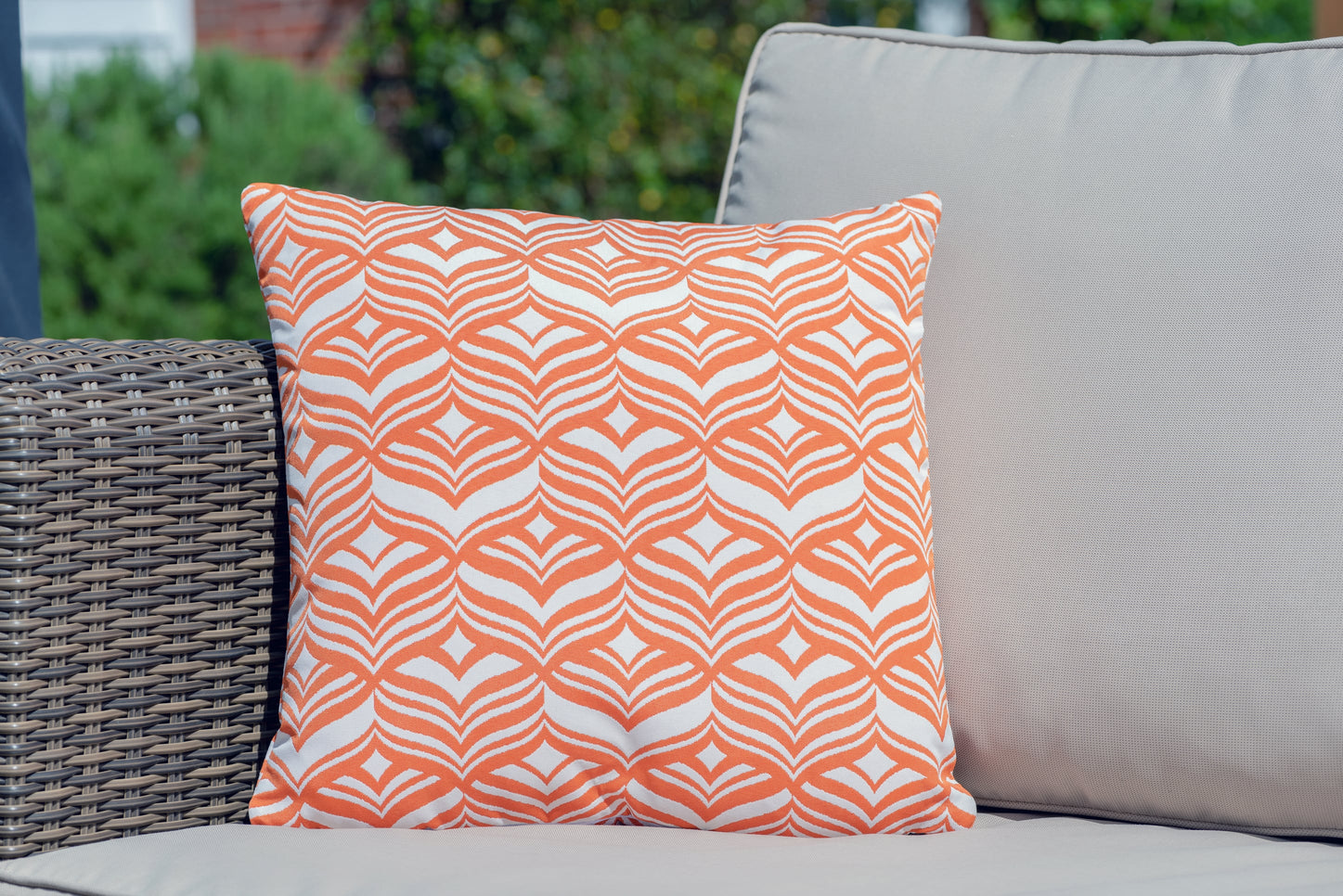 Armadillo sun waterproof cushion in dark orange and white tulip pattern