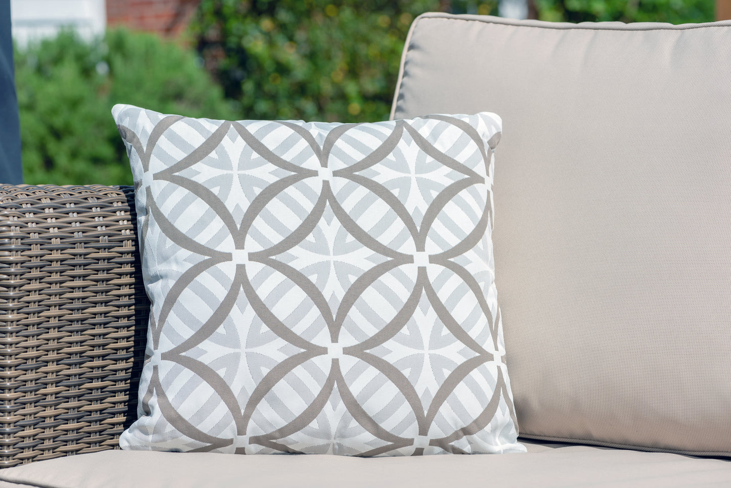 Armadillo Sun luxury waterproof cushion in neutral pumice and white palm pattern