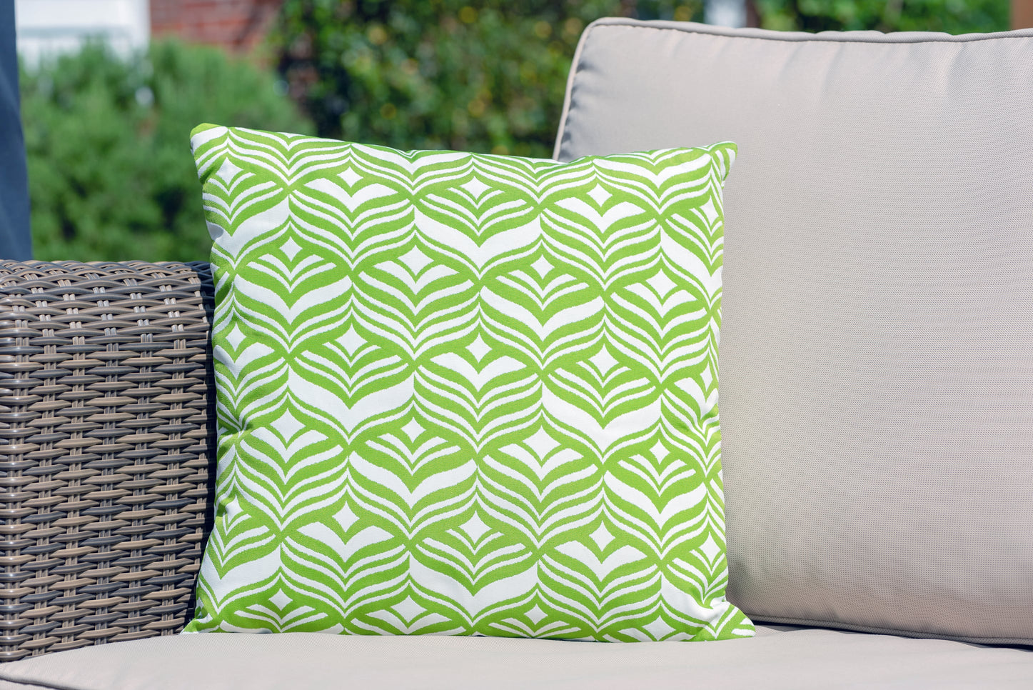Armadillo Sun waterproof cushion in green and white tulip pattern