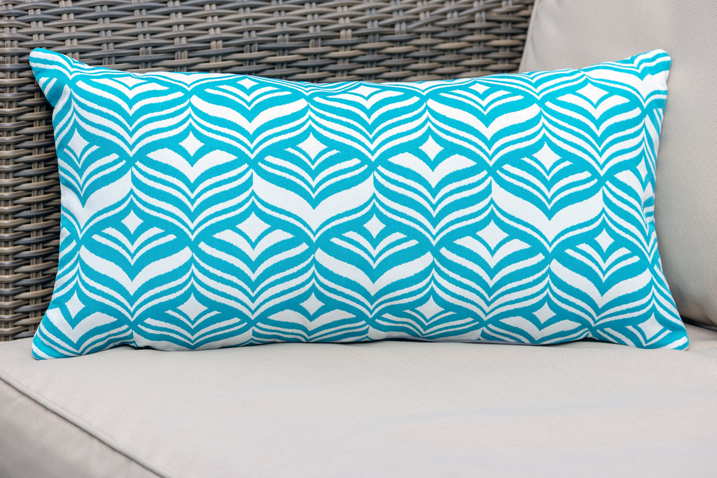 Armadillo Sun rectangular cushion in turquoise blue and white tulip pattern