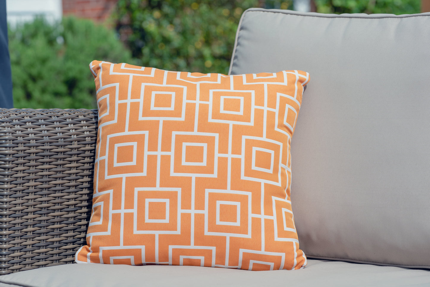 Armadillo sun waterproof cushion in orange aztec pattern