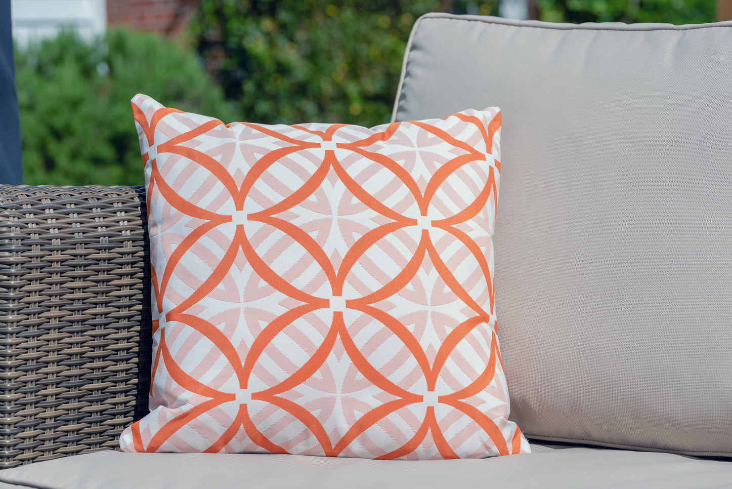 Armadillo Sun waterproof luxury cushion in orange and white coolum pattern