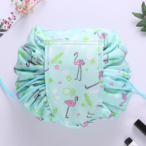 duesgo.com-Lazy Drawstring Cosmetic Travel Pouch-sky blue with flamingo creatures on it