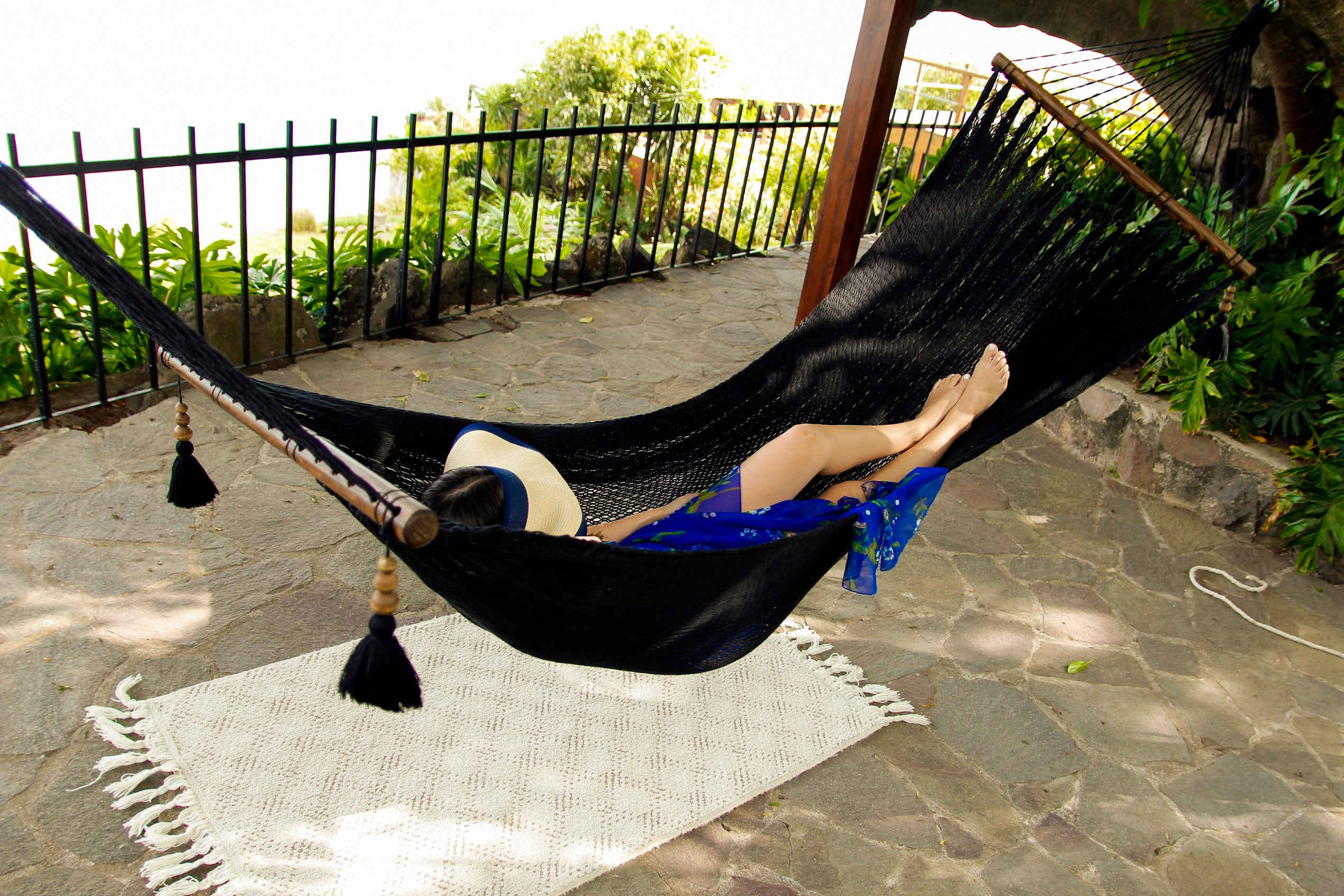 relaxing in a hammock with wood spreaders