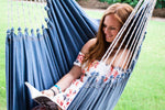 read book hammock swing chair outdoors porch swing patio