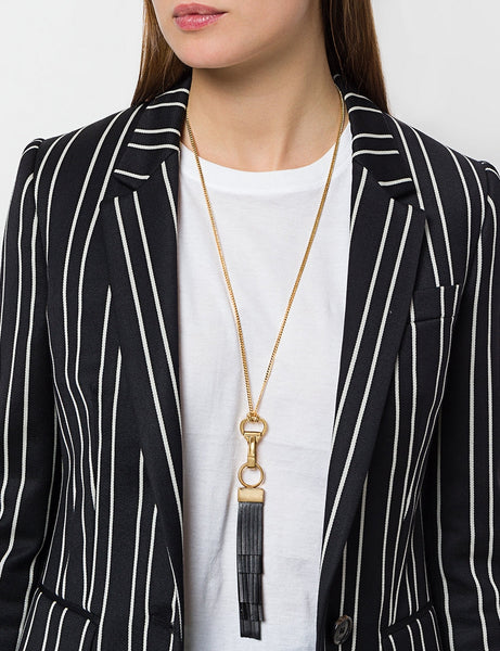 Coup de Coeur London Gold leather tassel pendant necklace worn