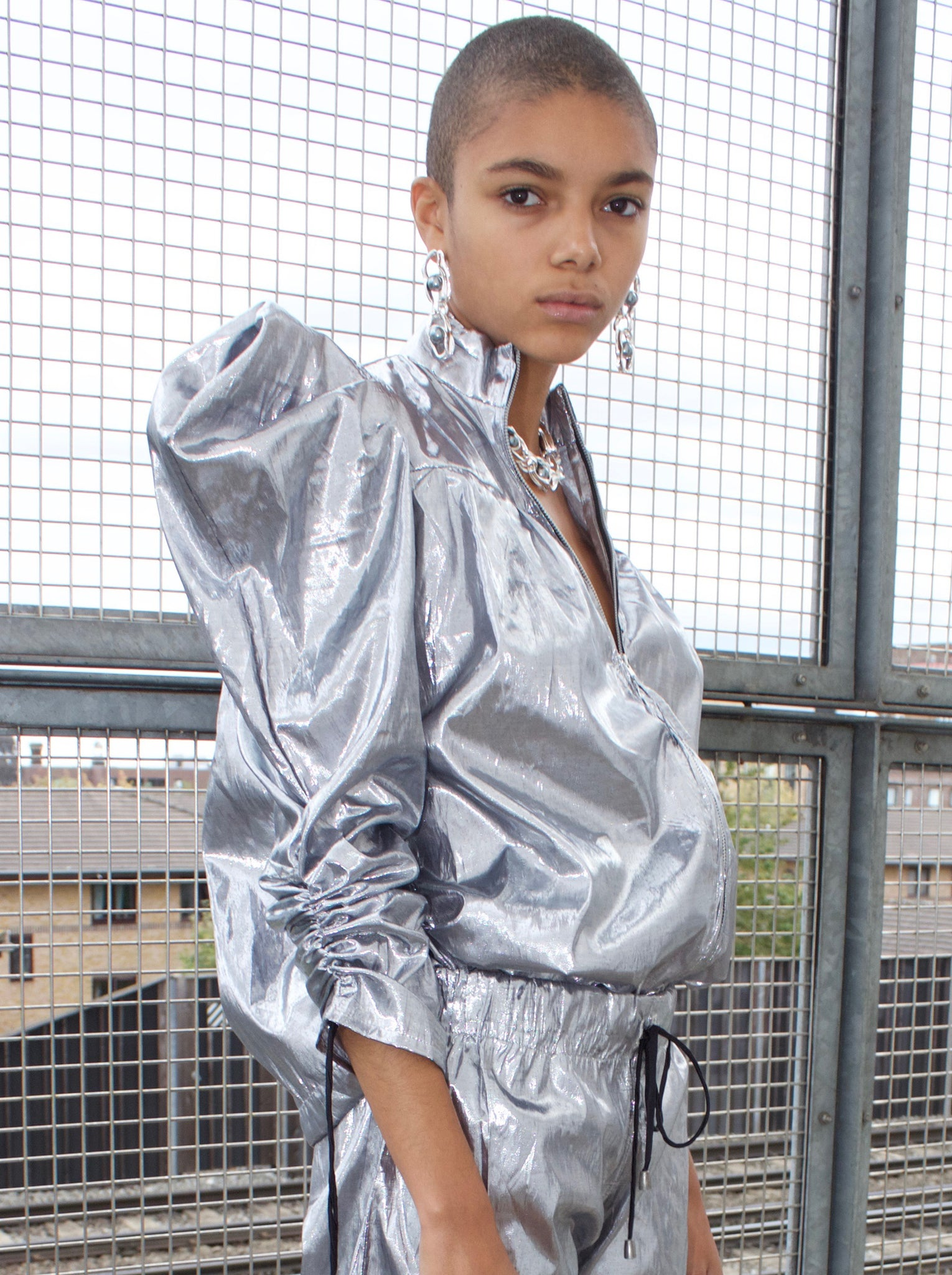 Coup de Coeur Silver metallic puff sleeve jacket worn by Iris Du Bois