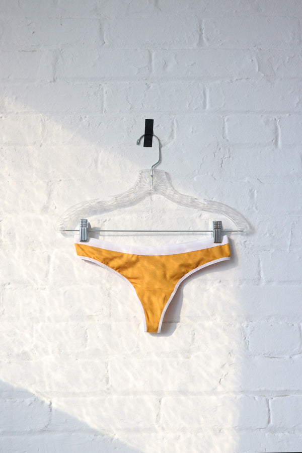 Emery Thong in Mustard