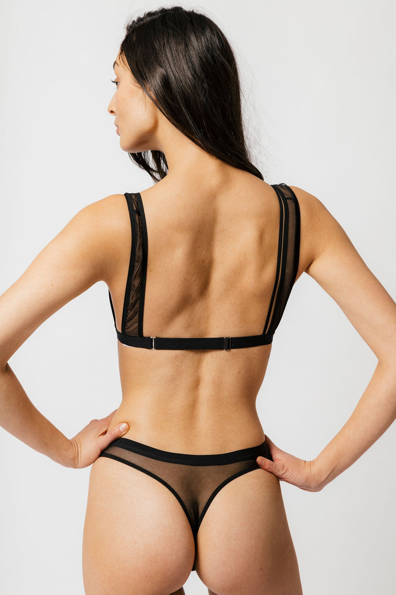 Emery Thong in Black