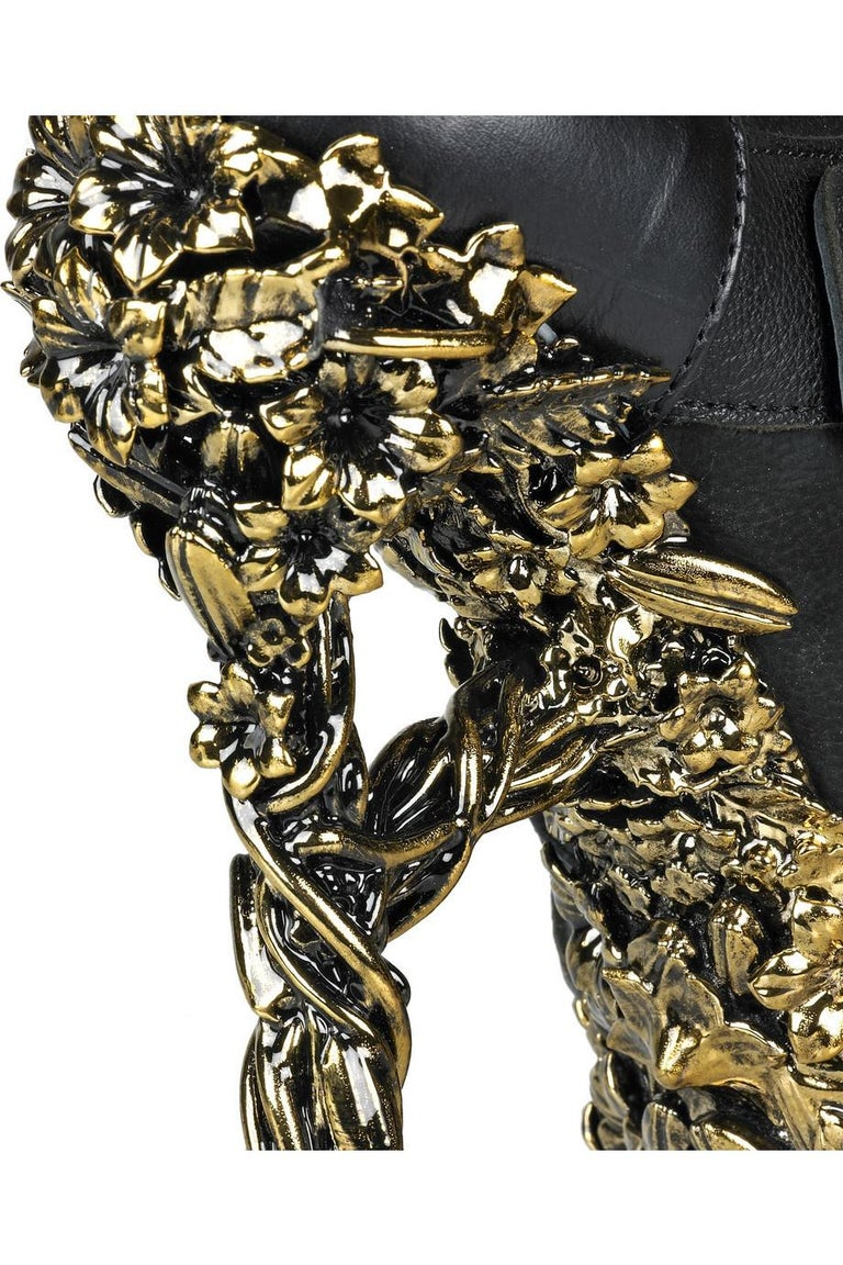 2010 ALEXANDER MCQUEEN Floral-engraved leather boots