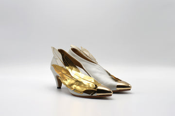 High heel shoes with gold and silver feathers. Designed by local Singaporean artist for the Art of School Competition