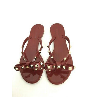 Plum rock stud jelly flip flops