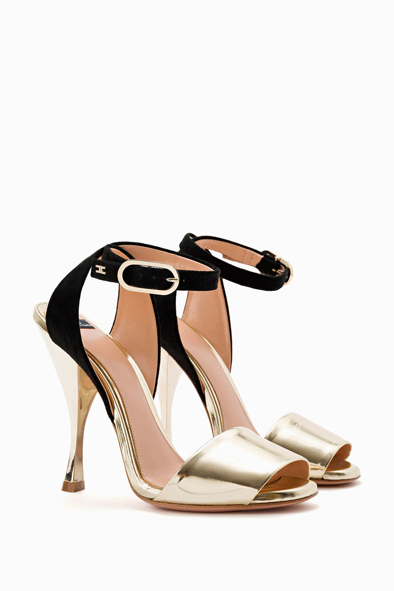 gold high heel sandals with black ankle strap