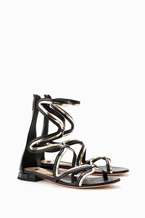 flat gladiator sandals in black and gold