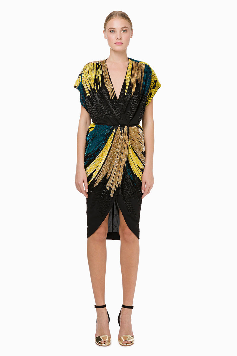 Embroidered cocktail dress in black and gold that wraps around