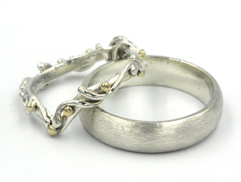 Pair of white gold and yellow gold wedding rings
