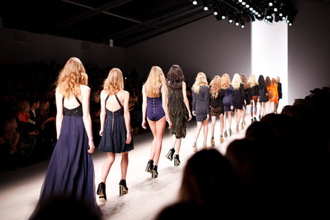 Models on the Catwalk dressed in navy blue