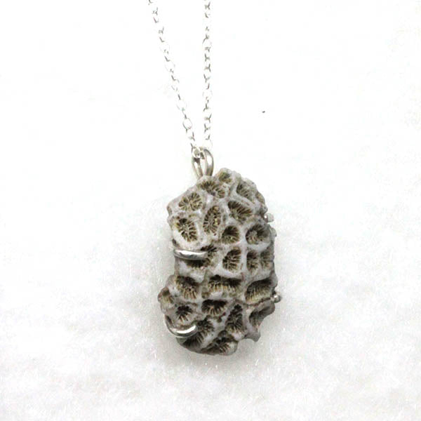 Handmade bespoke coral pendant in sterling silver and jamaican coral byt Gemma Tremayne Jewellery