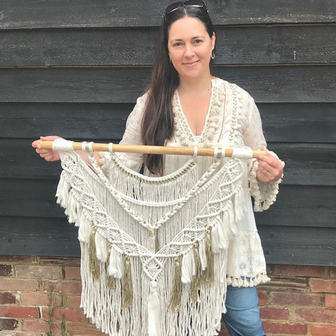 Kylie holding a large Grecian Goddess Wall Hanging