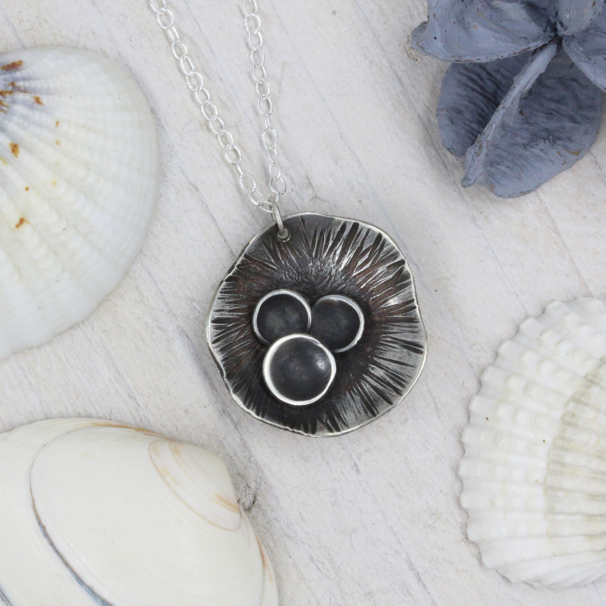 Rock pool inspired pendant, handcrafted in sterling silver by Gemma Tremayne Jewellery